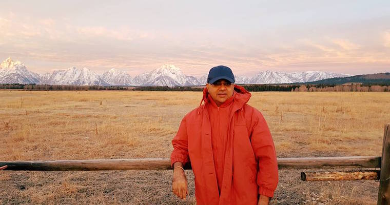 Articulate support team member Manish in front of the Grande Tetons