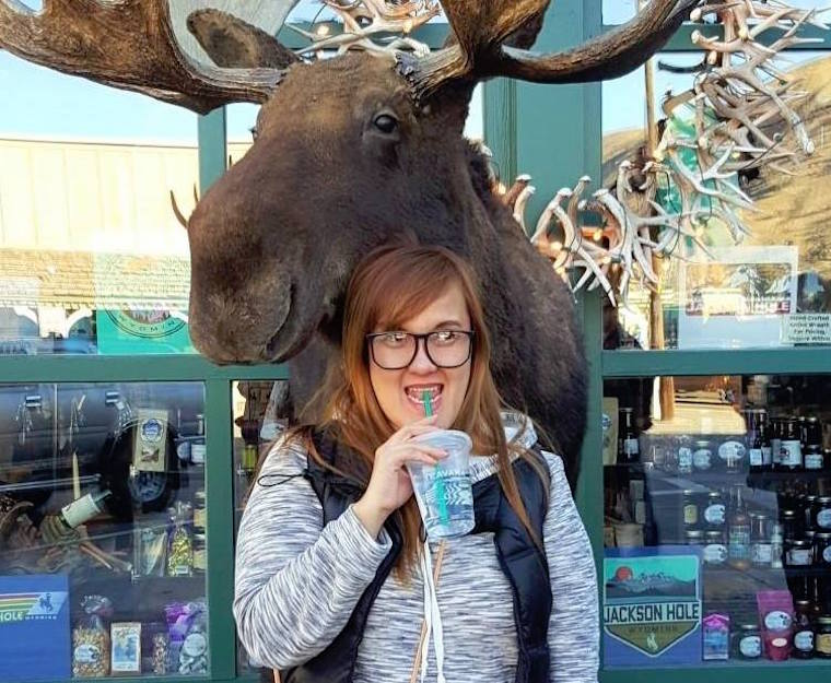 Support team member Vira with a stuffed moose head in Jackson Hole, WY