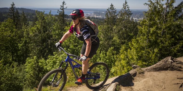 success coach tanya mountain biking on a ridge